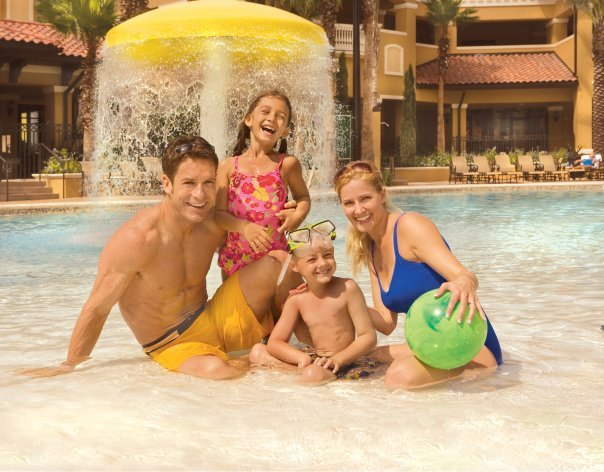 Family at pool at Floridays Resort Orlando.