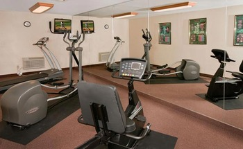 Fitness center at Best Western Ingram Park Hotel.