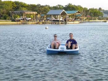 Paddle boating at Copano Vacation Rental Management.