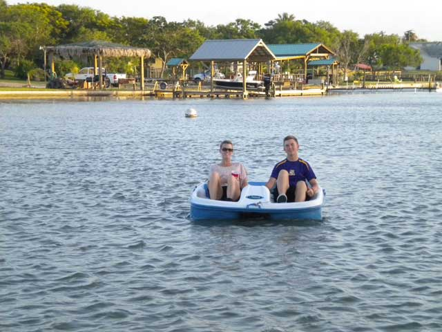 Paddle boating at Copano Vacation Rental Management.