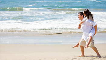 Couple On Beach at Hilton Garden Inn Outer Banks