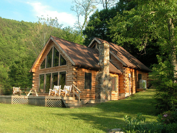 Cabin exterior at Harman's Luxury Log Cabins.