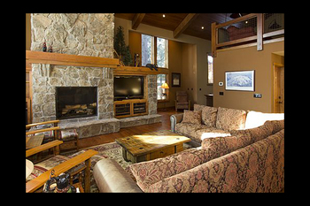 Vacation rental living room with fireplace at Mammoth Property Reservations.