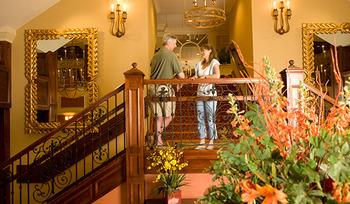 Couple on stairs at Villa Roma Resort.
