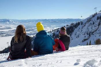 Family skiing at Rendezvous Mountain Rentals & Management.