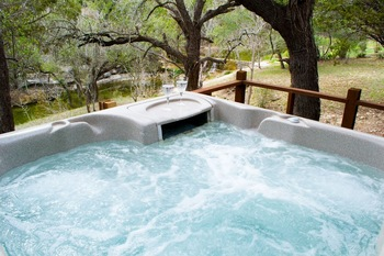 Rental hot tub at Hill Country Premier Lodging.