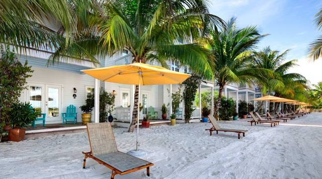 Lounge chairs on beach at Parrot Key Resort.