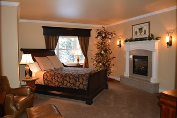 Guest suite with fireplace at Summer Creek Inn & Spa.