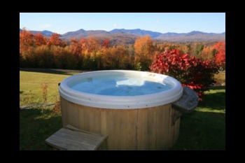 Vacation rental hot tub at Stowe Country Homes.