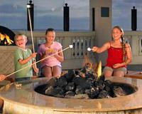 Roasting marshmallows by the fire at Manchester Grand Hyatt San Diego.