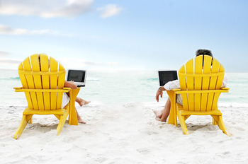 Chairs on beach at Southern Vacation Rentals.