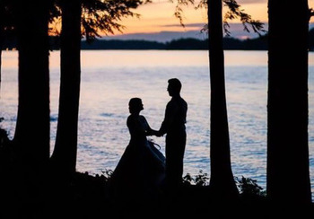 Couple by lake at Northridge Inn & Resort.