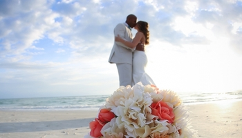 Wedding couple on beach at TradeWinds Island Grand.