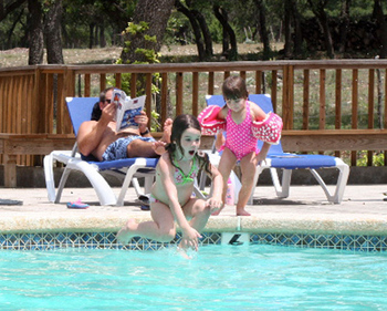 Swimming at West 1077 Guest Ranch.
