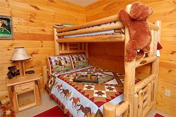 Cabin rental bedroom at Timber Tops Rentals.