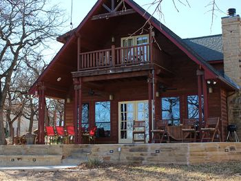Exterior view of Waterfront Luxury Lake Lodge.