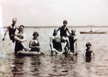 Historic photo of family swimming at Bonnie Beach Resort.