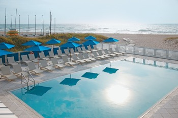 Outdoor pool and beach at The Seagate Hotel & Spa.