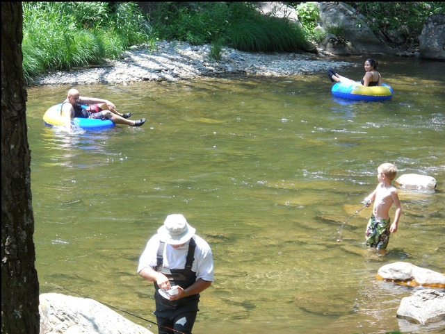 Fishing and tubing in the river at Yogi Bear's Jellystone Resort Cherokee.