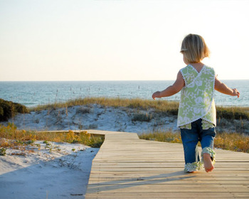 Child on boardwalk at Southern Vacation Rentals.