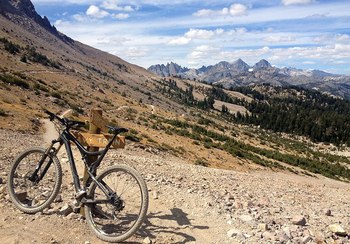 Biking along Mammoth Mountain at Seasons 4 Condominium Rentals.