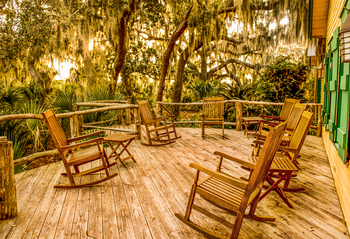 Comfortable rocking chairs on the Hunting Lodge patio at the Lodge on Little St. Simons Island.