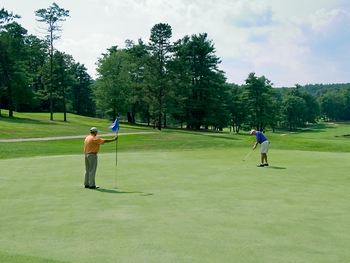 Playing golf at Toftrees Golf Resort and Conference Center.