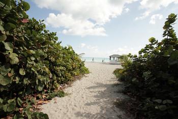 The beach at HORA Vacation Rentals.