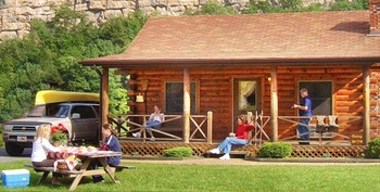 Log cabin exterior at Smoke Hole Caverns & Log Cabin Resort.
