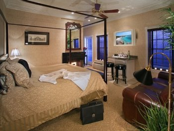 Luxury Parlor with a king bed, wood-burning fireplace, wet bar and soaking tub for two.