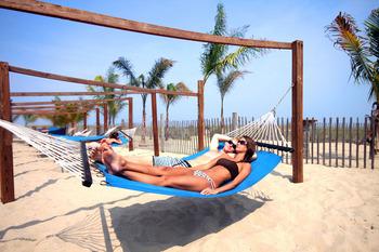 Relax on a hammock on the beach at Holiday Inn Oceanfront Ocean City.