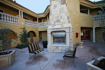 Outdoor Fireplace Area at Dry Creek Inn Hotel
