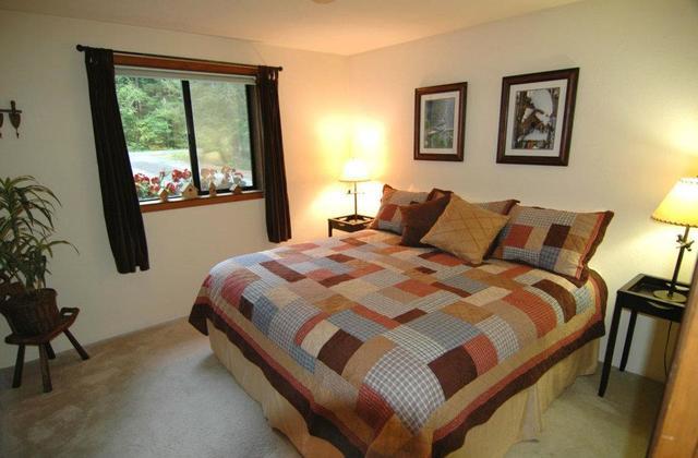 Cabin bedroom at Cedar Cabin on the Creek.