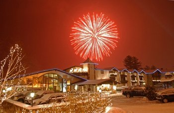 Exterior shot with fireworks at Golden Arrow Lakeside Resort.