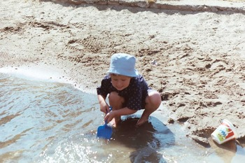 Playing on the sand at Twin Bay Village.