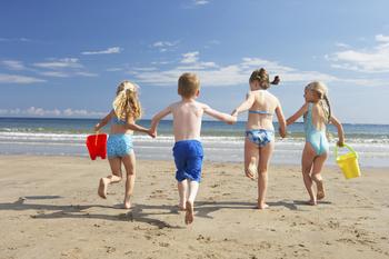 Family on the beach at Sea Oats Beach Club.