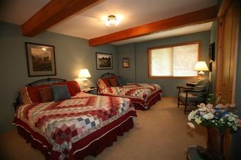Cabin bedroom at Western Pleasure Guest Ranch.