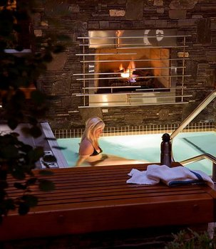 Hot Tub with Fireplace at The Banff Aspen Lodge