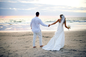 Wedding couple on beach at Ramada Plaza.
