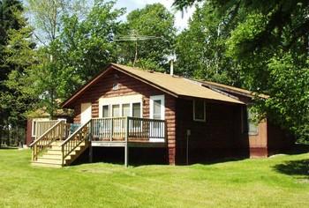 Cabin exterior at Voyageurs Sand Lake Resort.