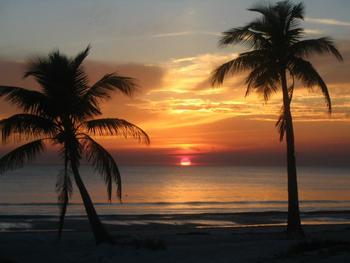 Beach sunset at Tri Power Resort Rentals.