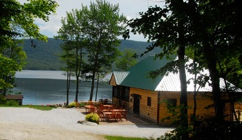 View of beach and pavilion on 740 acre lake at The Mountain Top Inn & Resort.