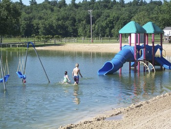 Water park and beach at Yogi Bear's Jellystone Park Warrens.