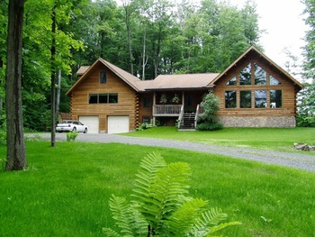 Exterior view of Log Haven Bed & Breakfast.