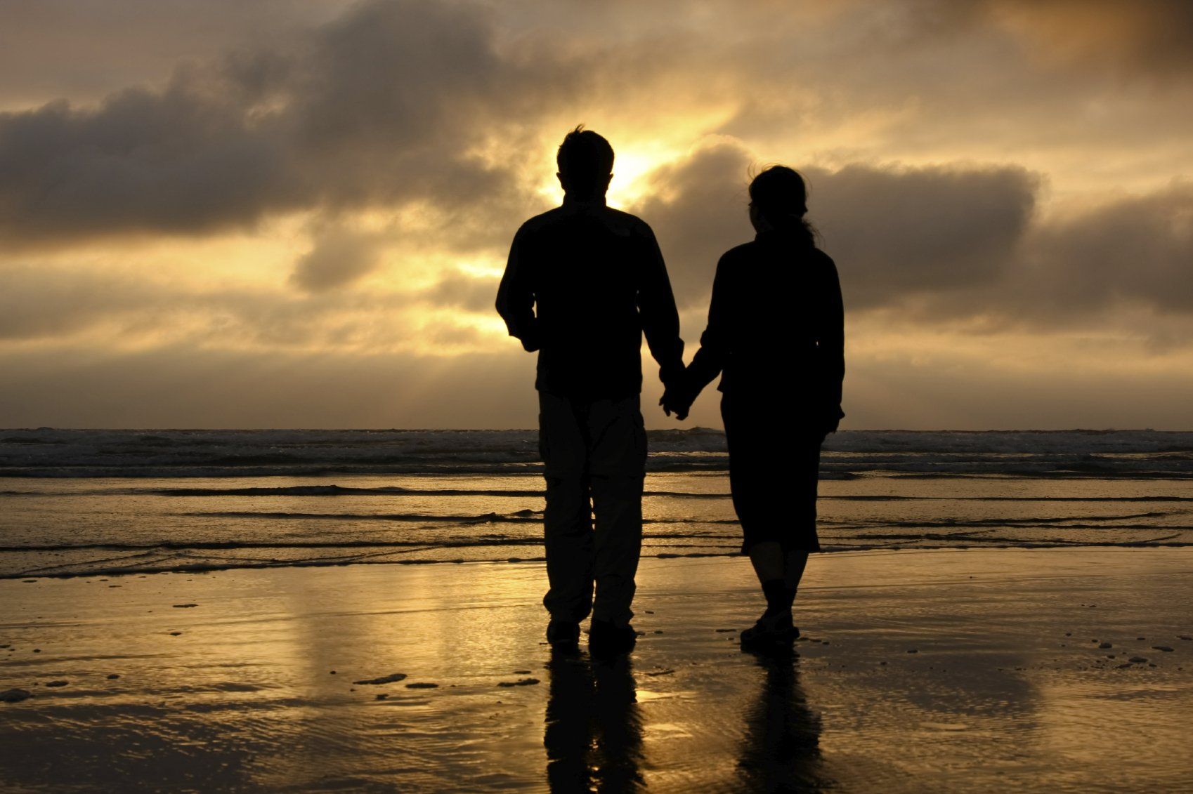 Couple on beach at Driftwood Shores Resort and Conference Center.