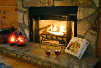 Cabin fireplace at Black Bear Cabin Rentals.