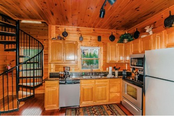 Cabin kitchen at Golfview Vacation Rentals.