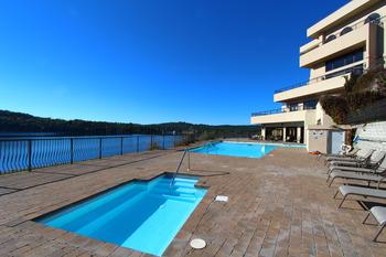 Pool and jacuzzi at D'Monaco Luxury Resort.