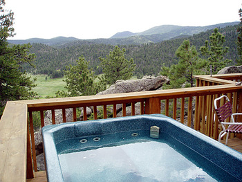 Cabin jacuzzi at Range Property Management.