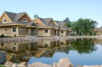 Cabin exteriors at Kavanaugh's Sylvan Lake Resort.